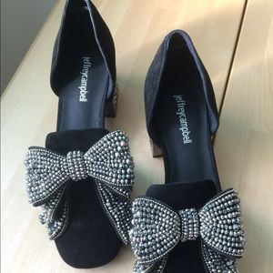 Black suede smoking pumps with bedazzled bows